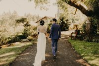 Bride and groom stroll beneath the Black Walnut tree (photo: Luke Liable Photography)