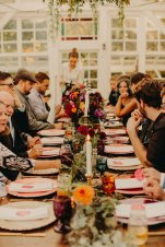 Long table wedding dinner in the conservatory (decor: Blue Lily Events, photo: Luke Liable Photography)